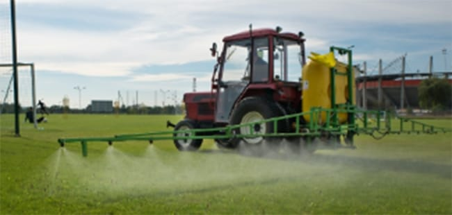 Field being sprayed with protectant